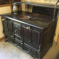 Ref. 08 – Antieke Luikse gietijzeren cuisinière foto 1